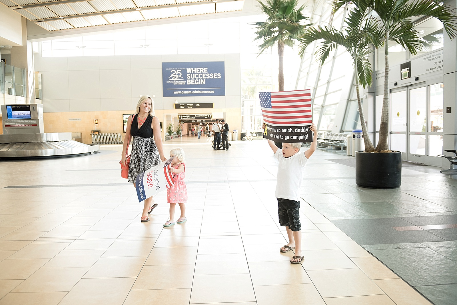 Military deployment Homecoming photography at the San Diego Airport by Lauren Nygard