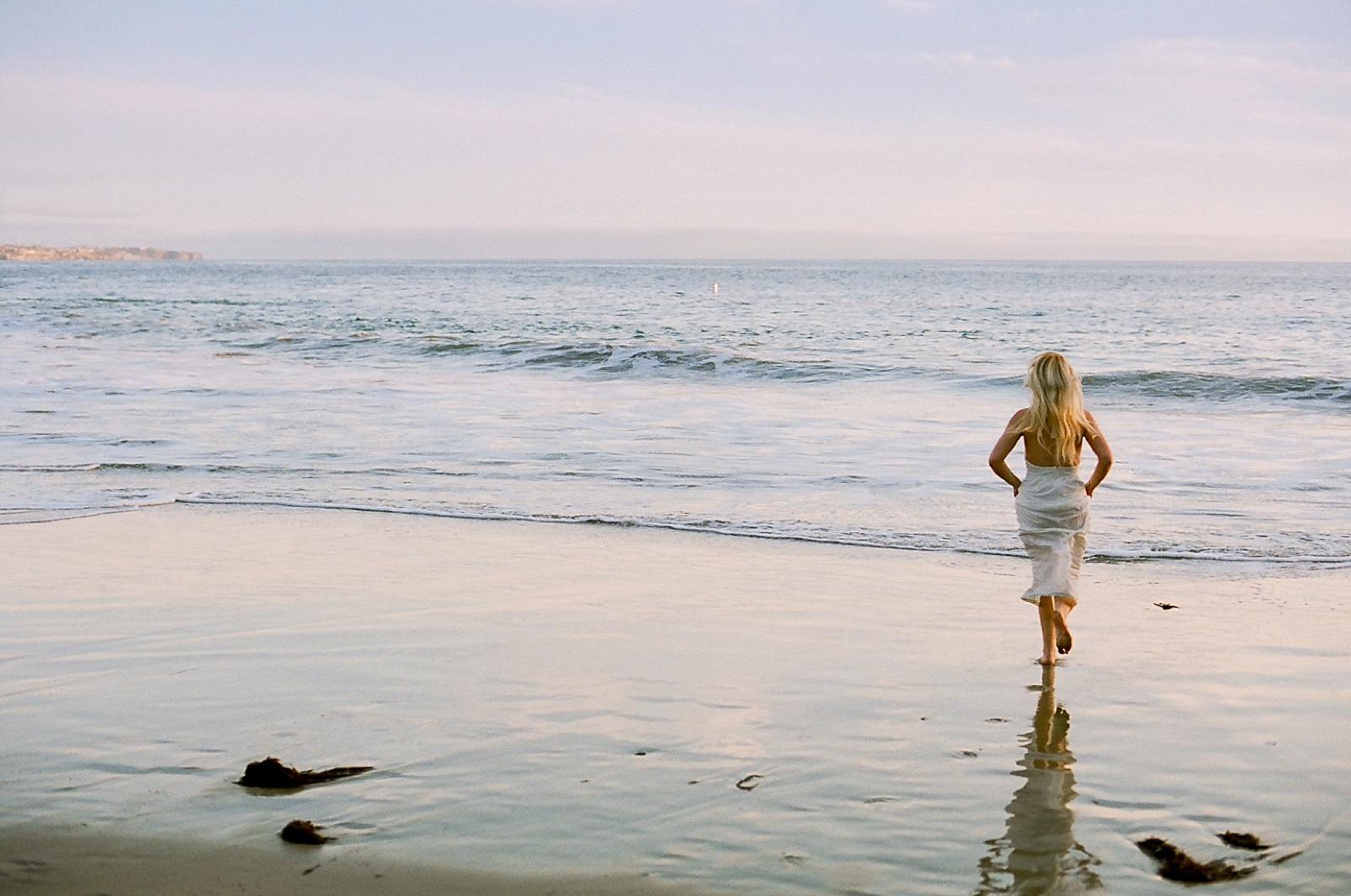 Beach couple's session on film by North Carolina photographer Lauren Nygard